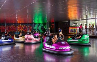 Children play bump car in an amusement park