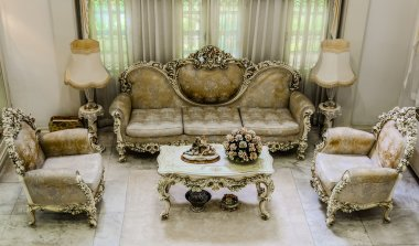 Upper angle of a living room with luxurious and classical haunting style furniture