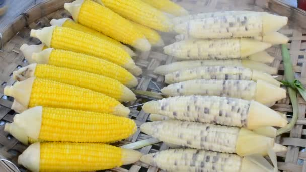 Boiled fresh steam corns and gummy corns vegetable grain organic food on Asian outdoor market are selected for sale 3