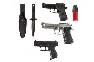 pistols, knife and pepper spray isolated on white background