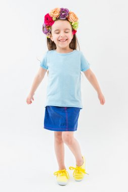 Active funny girl in a blue t-shirt and skirt.