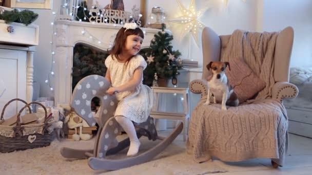 Girl and dog playing together.