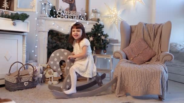Christmas Happy girl riding Rocking horse toy