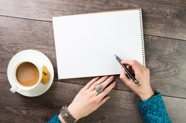 Designer draws sketches at the table coffee break