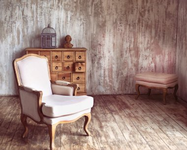 wooden chest of drawers in shabby styled room with bird cage and