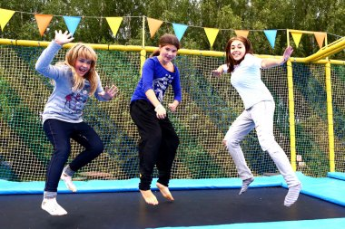 girls  on trampoline  in  park for sport activities
