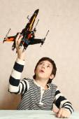 boy play with toy space shuttle close up portrait