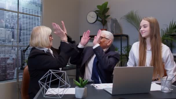 Company collegues joining hands give high five in air celebrating corporate unity success at office