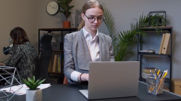 Young business woman freelancer concentrated developing new project while looking on laptop screen
