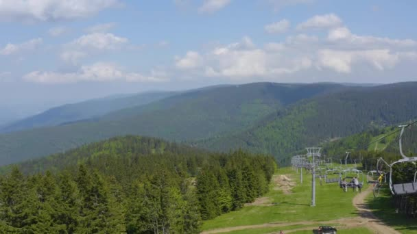 Aerial view of mountain bikers ascending the Kope downhill park on a ski lift in the summer