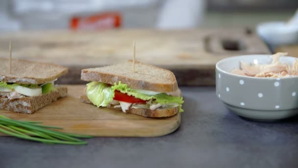 Two prepared sandwiches on table