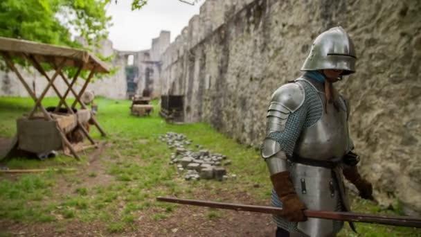 knight walking around inside castle walls