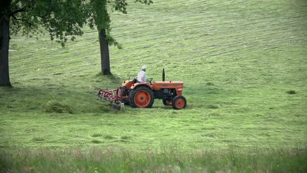 field with tractor turning around grass