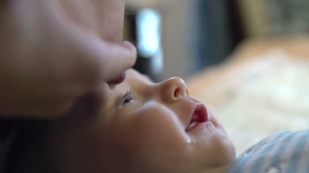 mothers nipple and dropping a droplet of milk into babys eye