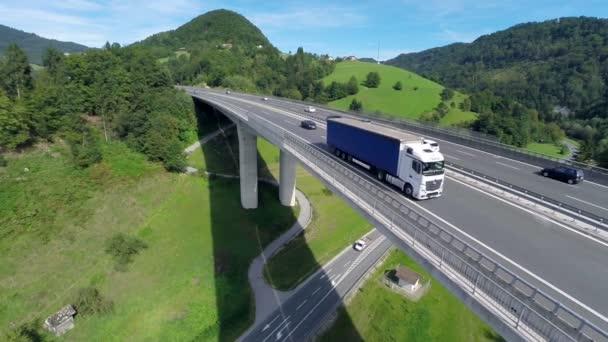 Big truck passing the camera on a bridge