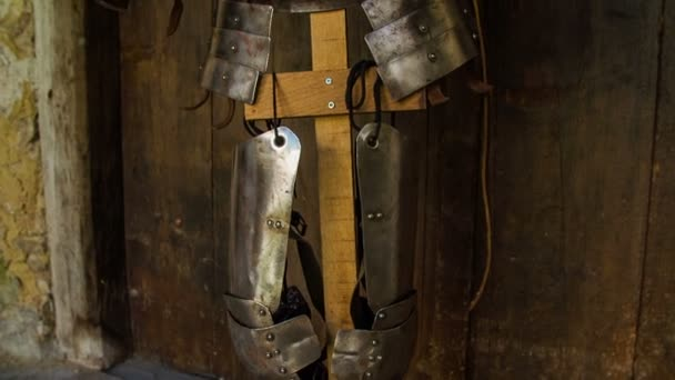 Medieval military armor on a wooden stand