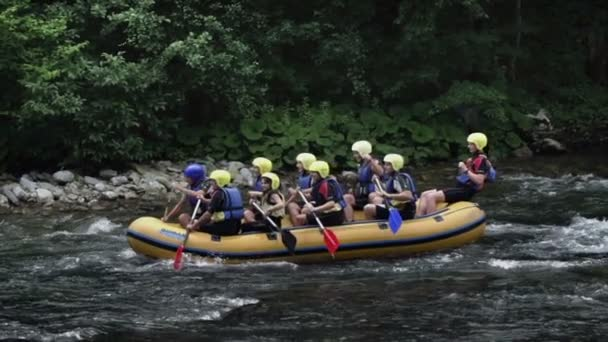 rafting team on fast river