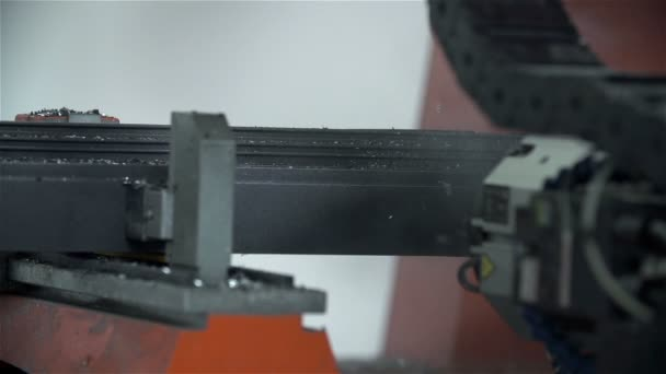 Machine drilling holes into metal