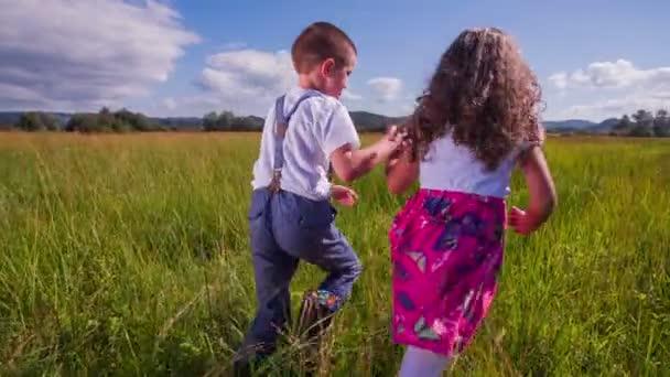 young kids running on a green grass