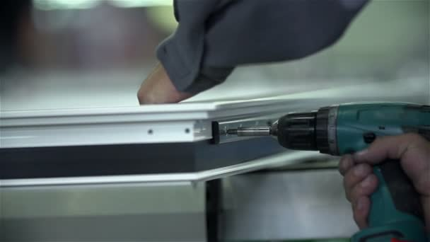 Man screws a screw into fetters