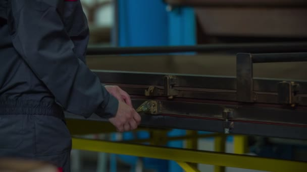 Person fastens metal fetters into special frame