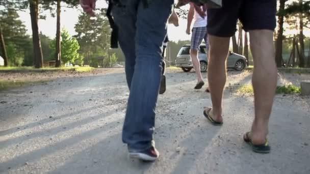 Some people walking on dusty roade