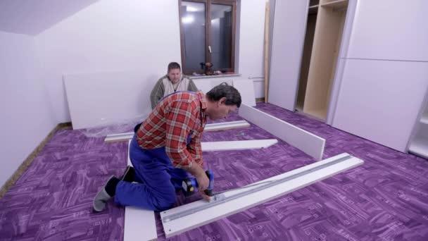 men are assembling new furniture