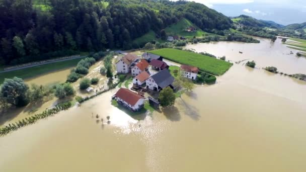 Home buildings in flood water with sun shining