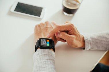 Male Using Smart Watch