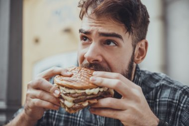 Male Eating Burger