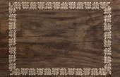 Celtic border knotwork ornament design wooden background
