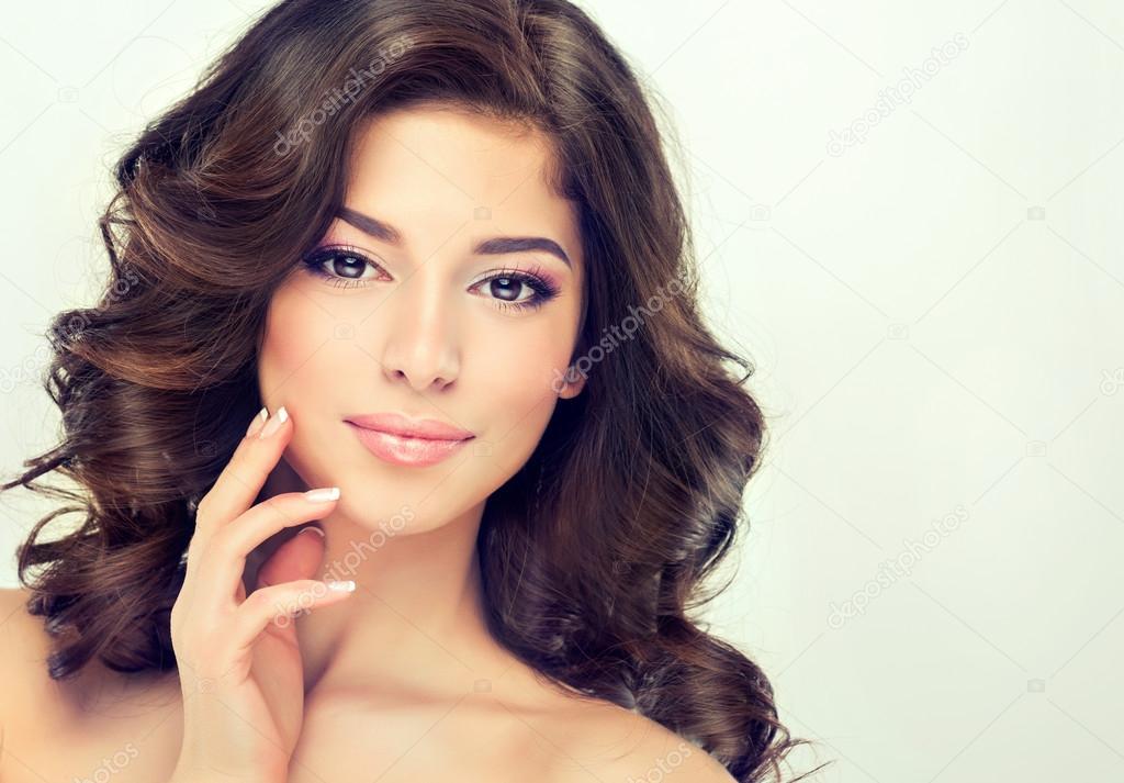 Beautiful girl with brown wavy hair