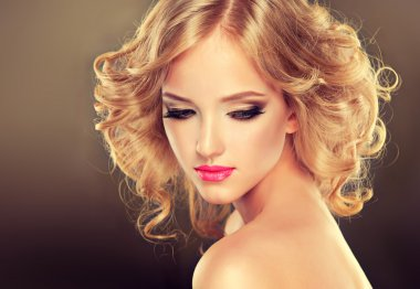 Blonde girl with luxury hairstyle and makeup