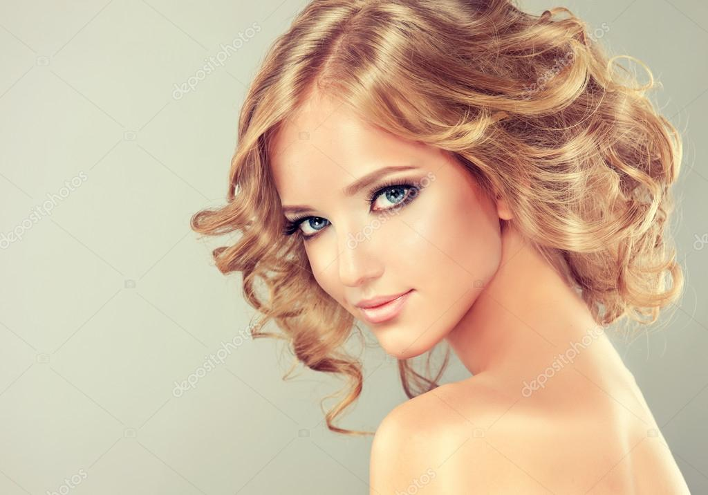 Blonde girl with hairstyle curled hair