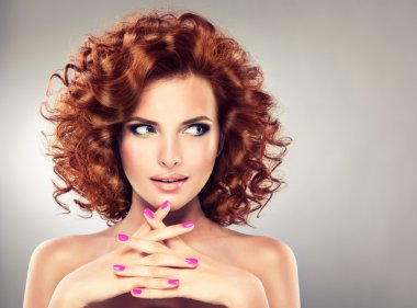 Redhead woman with  manicure