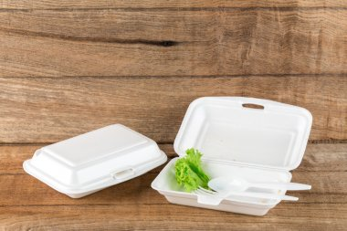 Foam boxes with scraps left over from eating stock vector