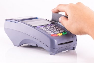Hand Swiping Credit Card On Credit Card Machine