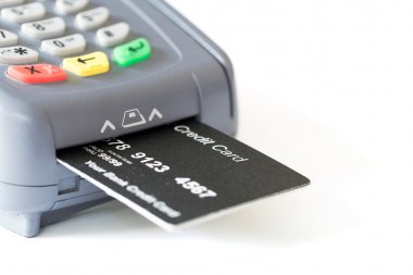 Credit card and card reader on white background with copyspace