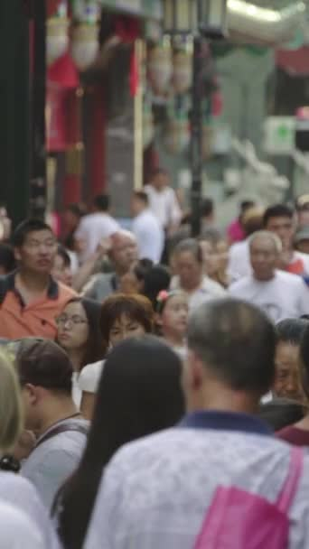 A crowd of people on the streets of the city. Beijing. China. Vertical video