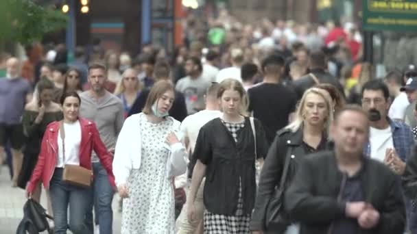 A crowd of people on the street of a big city, slow motion