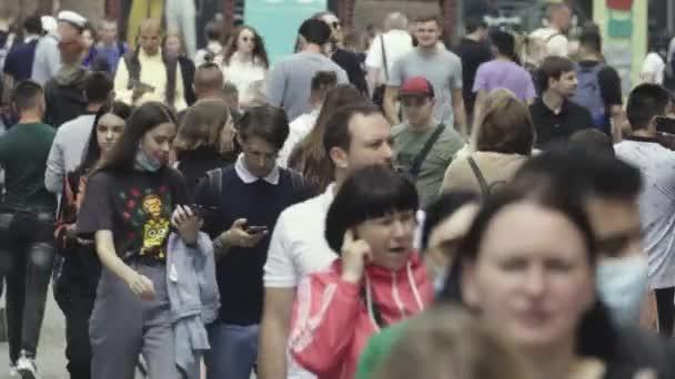 Many people walk along the street of the metropolis