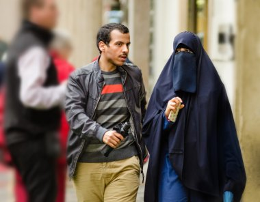 Young Muslim couple walking in Old Prague