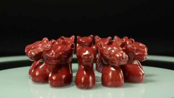 Rotating red jasper horse head statuettes
