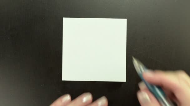 Drawing smiley face Straight Face on note paper