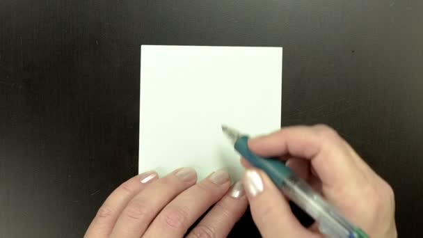 Drawing smiley face Winking on note paper