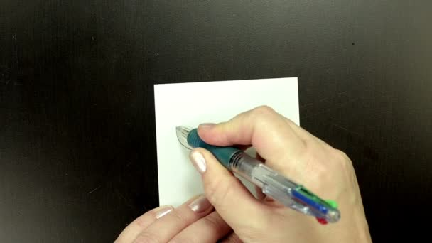 Drawing smiley face Tongue on note paper