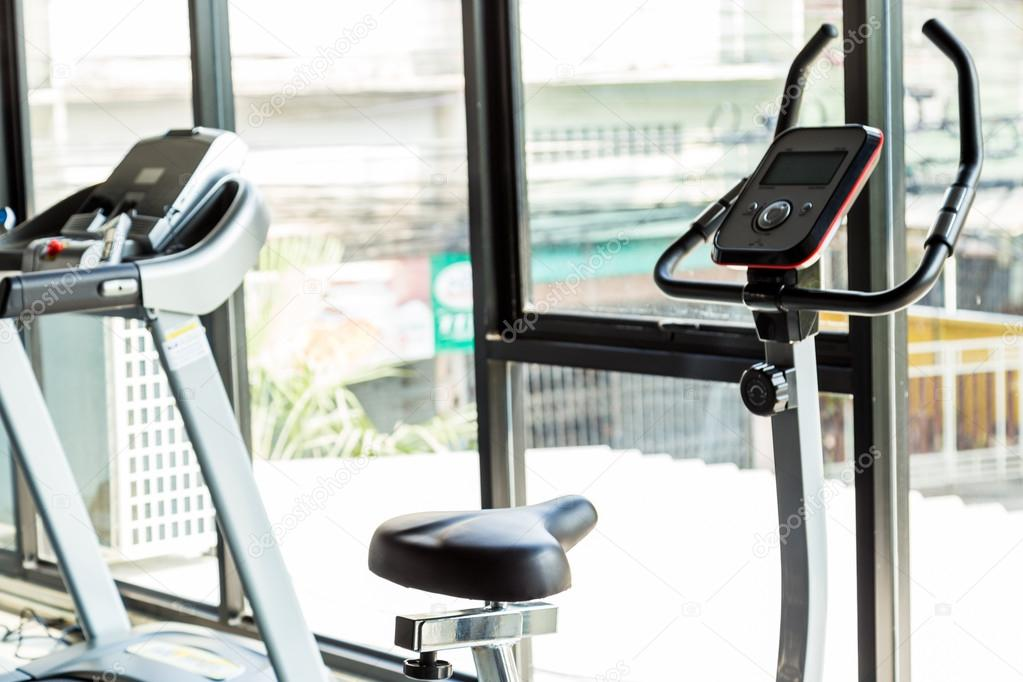 Exercise Bikes In City Gym Fitness And Health Care Concept Stock
