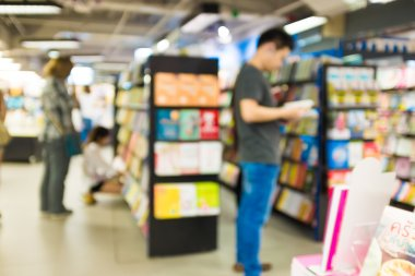 Blur image of People reading and shopping book
