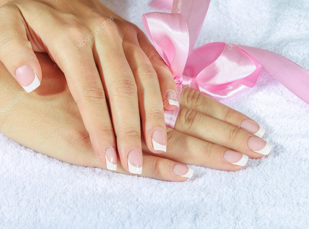 French manicure with pink and red hearts on the nails. — Stock Photo ...