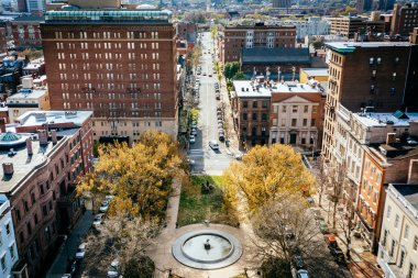 View of a park and Monument Street, in Mount Vernon, Baltimore,